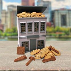 Wooden building filled with Cookies and Chocolate tools gift box
