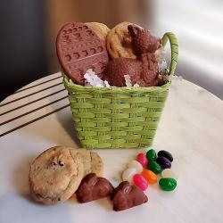 Easter basket filled with cookies and Easter chocolates