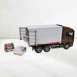Plastic container truck filled with chocolate building supplies